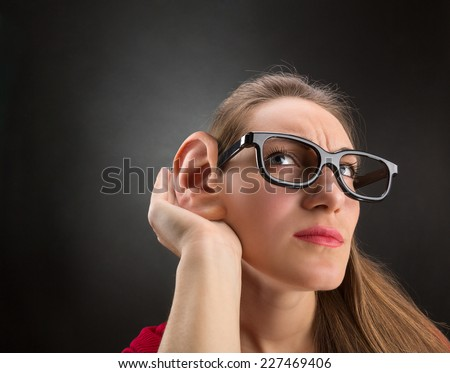 Woman is listening to - stock photo