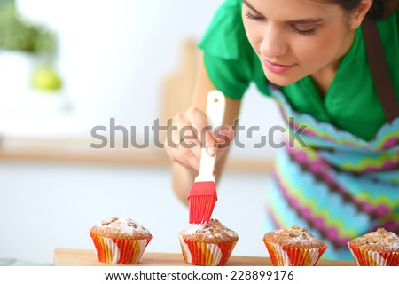 Woman is making cakes in the kitchen - stock photo