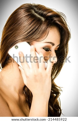 woman is phoning by mobile phone