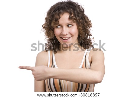Woman is pointing to the left and smiling Beautiful girl is showing a direction with her hands. Isolated on a white background. - stock photo