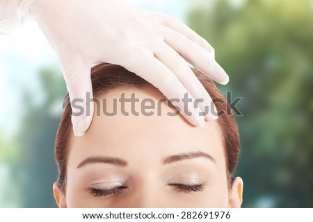 Woman is preparing to plastic surgery. - stock photo