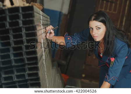 woman is recording and accounting of metal profiles in stock - stock photo