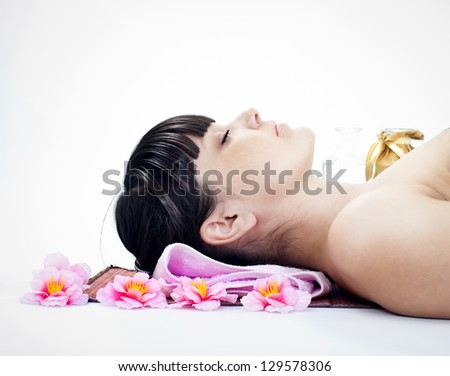 woman is relaxing in spa with closed eyes