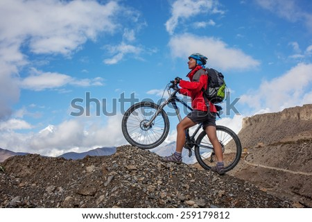 Woman is riding mtb bike in Himalaya mountains, Anapurna region