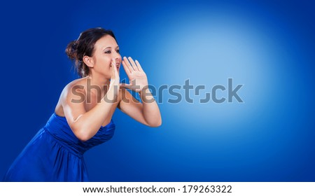 Woman is screaming in front of a  blue backround - stock photo