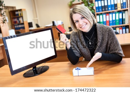 Woman is shopping via the Internet using a credit card - stock photo