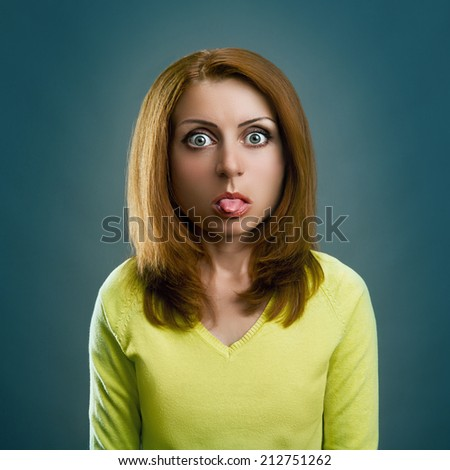 Woman is sticking out her tongue - stock photo