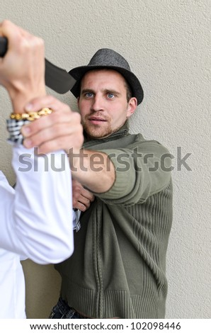 Woman is trying to kill man by knife. - stock photo