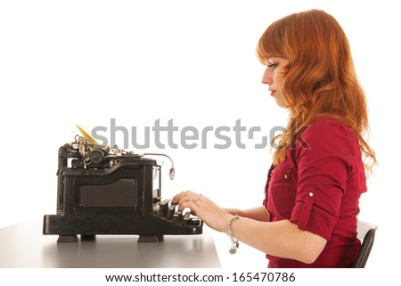 Woman is typing on black vintage typewriter isolated over white background