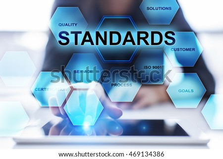 Woman is using modern tablet pc and selecting Standards concept.