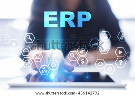 "Woman is using tablet pc, pressing on virtual screen and select ""ERP"". - stock photo"