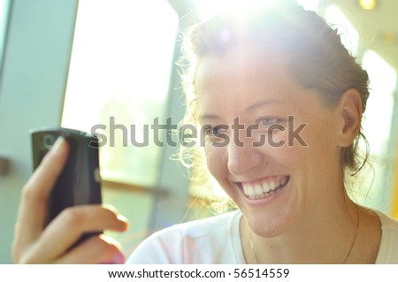 woman is watching at phone - stock photo