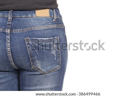 woman is wearing blue jeans, on white background
