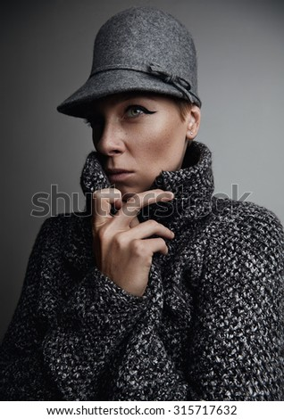 woman is wearing wool jacket and freezing - stock photo