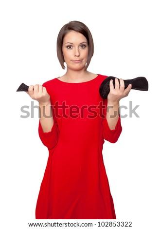 woman is wondering about her broken shoe heel - stock photo
