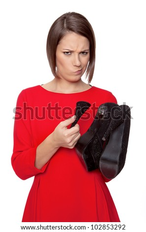 woman is wondering because her shoe heel is broken - stock photo