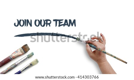 Woman is writing JOIN OUR TEAM with paintbrush.