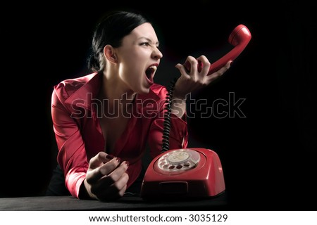 woman is yelling in the telephone - stock photo