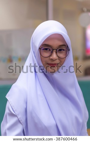 Woman Islam. With white headscarf in Thailand. - stock photo