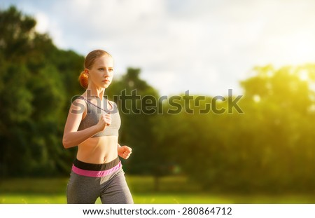 woman jogs runs  along the road on nature - stock photo