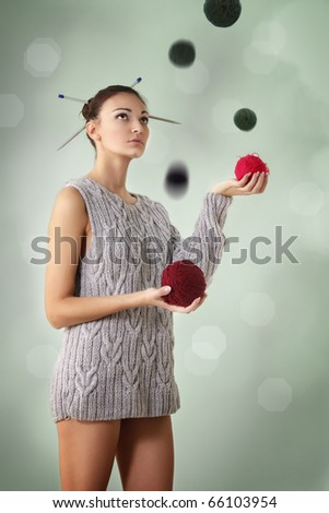 woman juggle clew with one sleeve sweater - stock photo