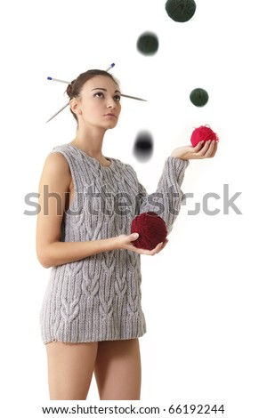 woman juggle clew with one sleeve sweater isolated on white background - stock photo