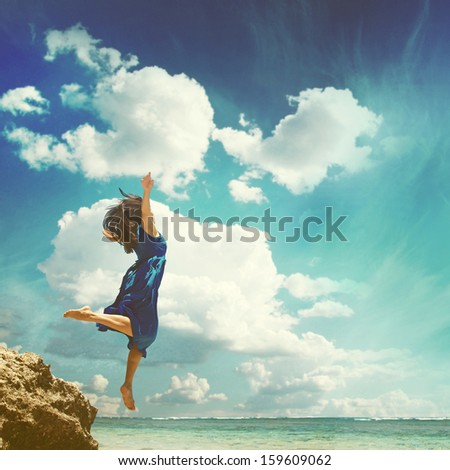 woman jumping to the sky - stock photo