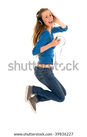 Woman Jumping with Headphones - stock photo