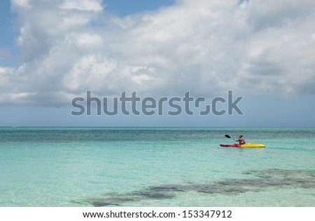 Woman kayaking on Grace Bay in Turks & Caicos
