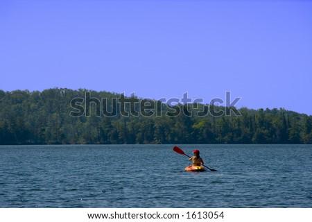 Woman Kayaks on Bay Lake (Brainerd, MN) - stock photo