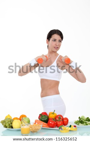 Woman keeping fit and eating healthily - stock photo