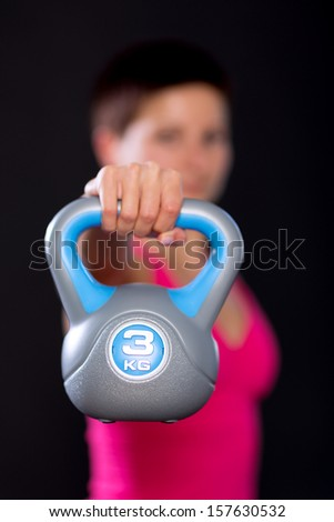 Woman kettlebell closeup - stock photo