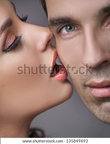 Woman kissing her man - stock photo