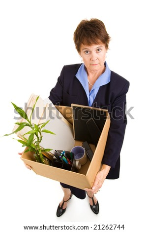 Woman laid off from work, carrying her belongings in a box.  Full body isolated on white. - stock photo