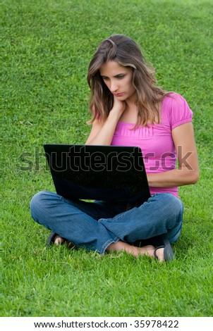 Woman laptop sit grass - stock photo