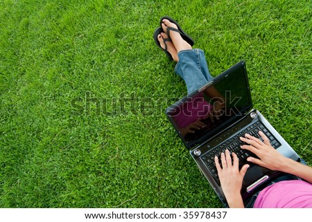 Woman laptop sit grass - stock photo