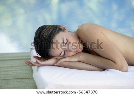 Woman laying at a poolside