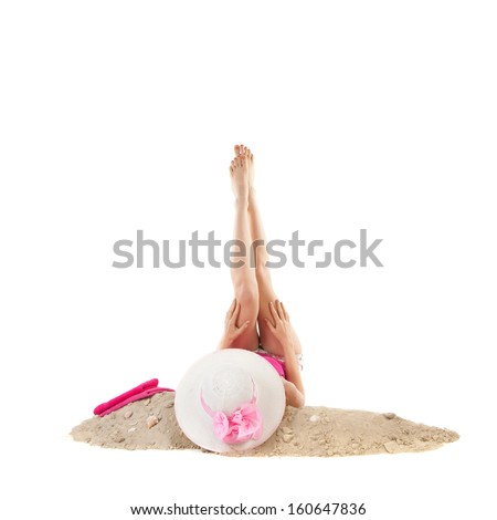 woman laying at the beach with pink hat in studio isolated over white background - stock photo
