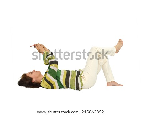 Woman Laying down holding hand held device looking up isolated on white background - stock photo