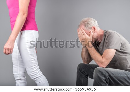 Woman leaving her husband - stock photo