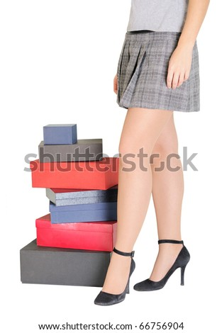 Woman legs and boxes for moving. Isolated on white. - stock photo