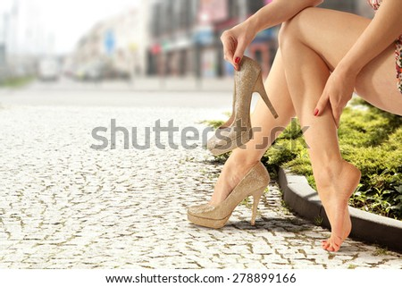 woman legs and city