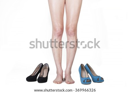 Woman legs and shoes on white background - stock photo