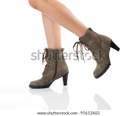 woman legs in boots - stock photo