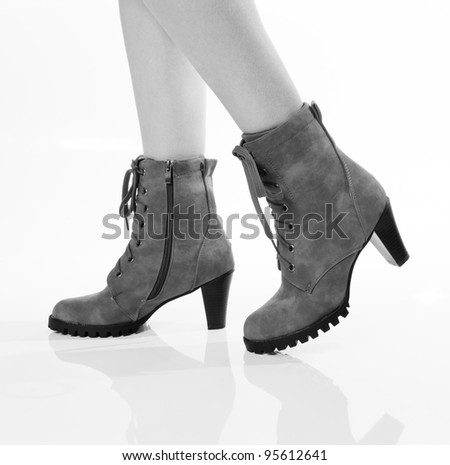 woman legs in boots black and white - stock photo