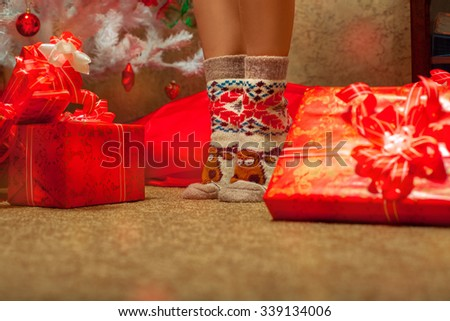 Woman legs in funny christmas socks. Christmas mood. New year.