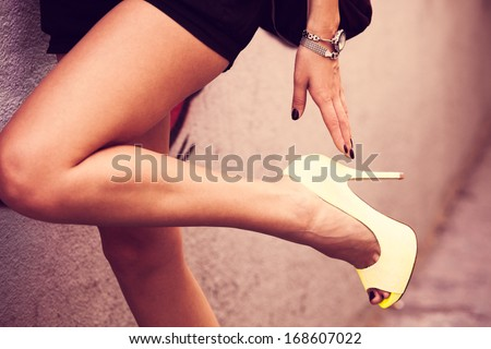 woman legs in high heel shoes outdoor shot - stock photo