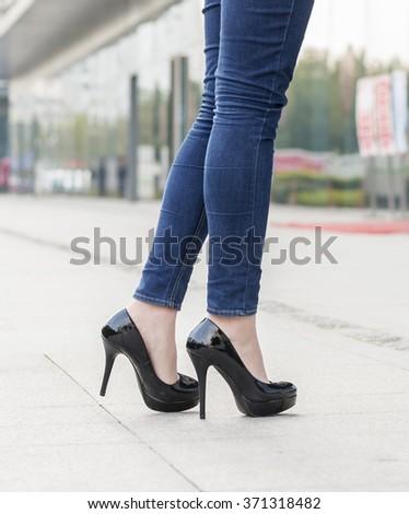 woman legs in high heel shoes outdoor shot - stock photo