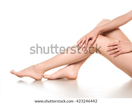 woman legs isolated on white. Depilation or another healths concept
