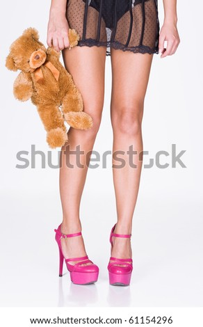 Woman legs, lingerie and teddy bear